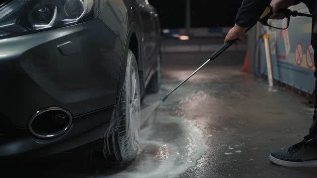 Car wash and care. Pressure wash with water and foam car wheel video