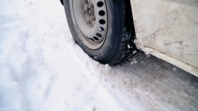 car wheel on a winter road video