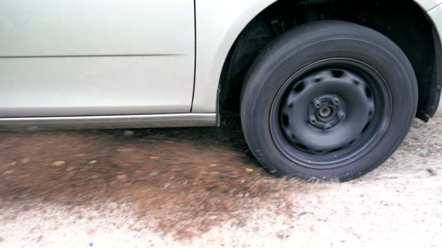 Car wheel skidding on ground video
