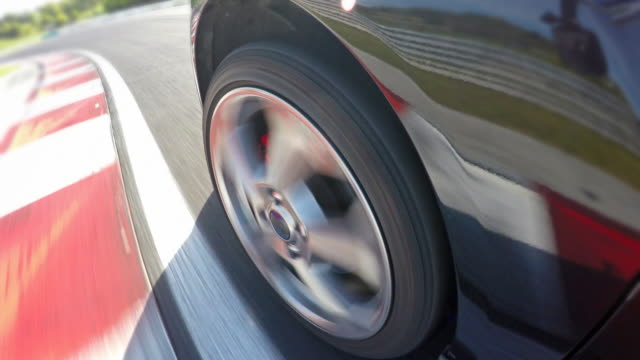 Car wheel spinning at a race track video