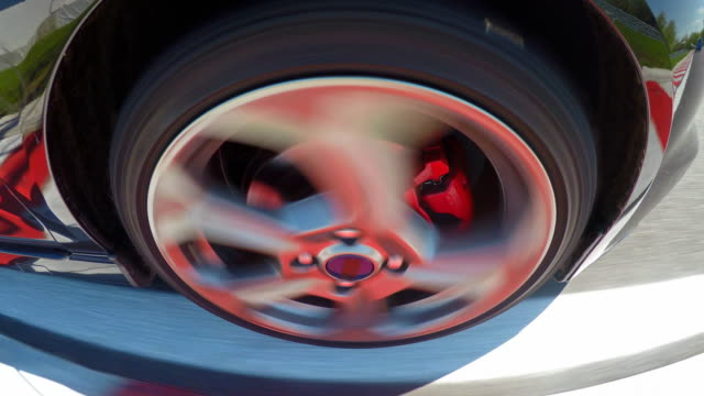 Car wheel spinning while driving fast at a race track video