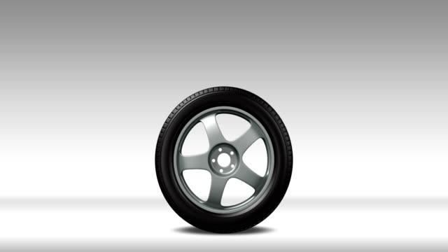 bil rullar med nya däck rullade in ram, slutar, och rullar ut - alfa matt - wheel black background bildbanksvideor och videomaterial från bakom kulisserna