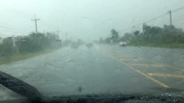 Car wipers are removing rain at slow and drive on road video