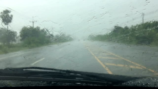 car wipers are removing rain at slow and drive on road - lama oggetto creato dall'uomo video stock e b–roll