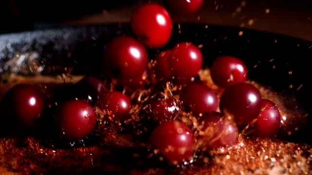 Caramelized cherries. Throwing and mixing cherries with caramel