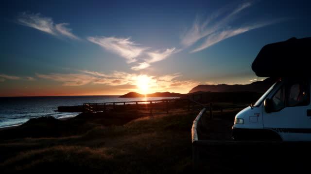 Caravan camping on beach at sunset video