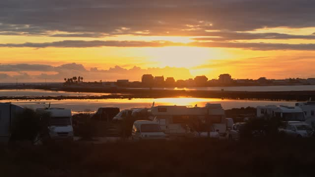 A caravan park on the banks of the Ria Formosa, overlooking the sunset and the beaches. Faro Portugal
