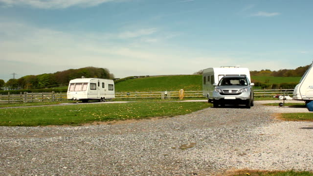 Caravan trailer towed on a campsite video