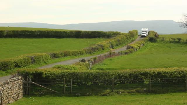 Caravan trailer towed through the countryside video