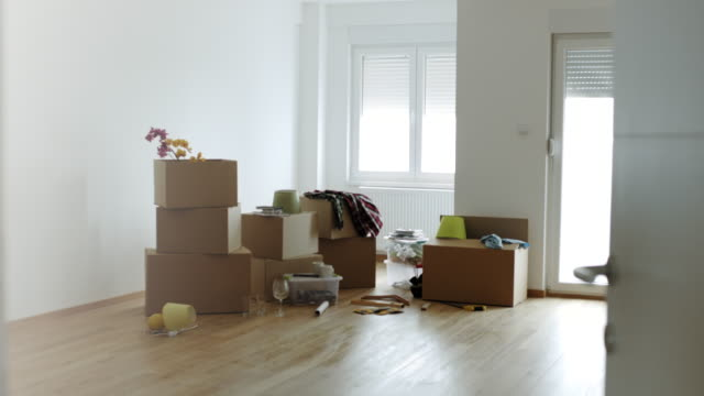 cardboard boxes for moving into a new home - new home stock videos & royalty-free footage
