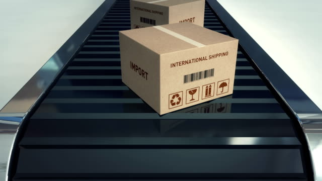 Cardboard boxes on conveyor belt | Import video