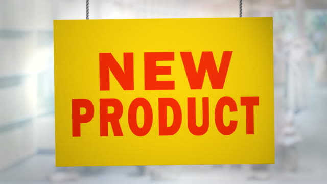 Cardboard new product sign hanging from ropes. Luma matte included so you can put your own background. Cardboard new product sign hanging from ropes. Luma matte included so you can put your own background announcement message stock videos & royalty-free footage
