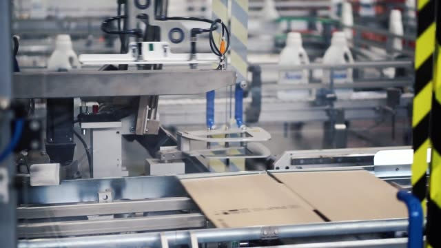 Cardboard package box packing machine. Clip. Box forming production line video