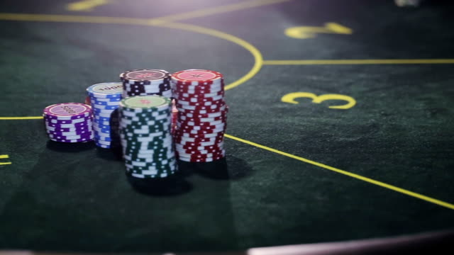 Cards being dealt at poker game in the casino video