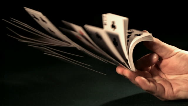 Cards flipping out of hand in slow motion