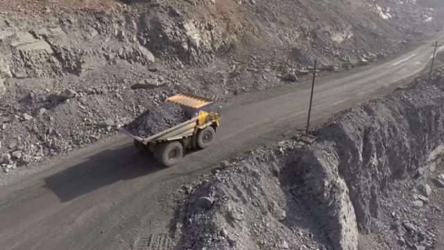 Career. Flight for BelAZ. The machine carries iron ore.