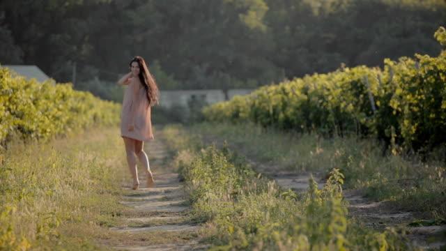 Carefree girl walking along the vineyards video