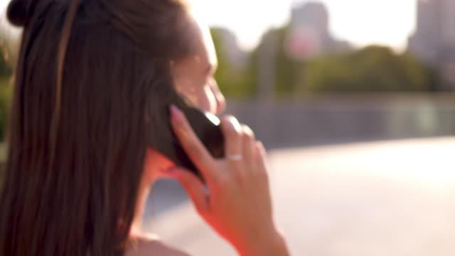 Carefree teenager talking on phone while walking on street video