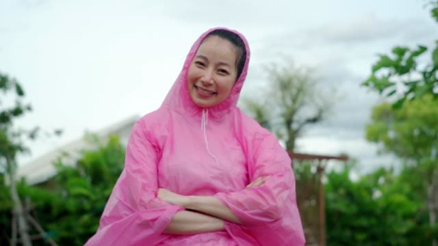 Carefree young woman in Raincoat, Slow Motion.