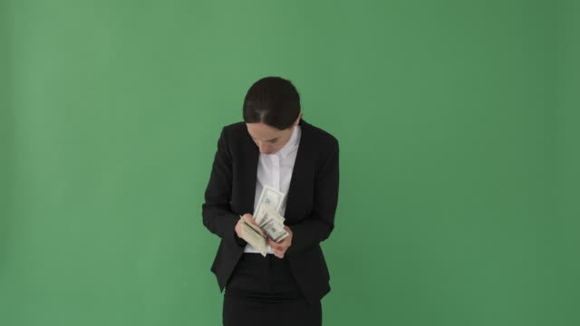 vídeos de stock e filmes b-roll de careful businesswoman hiding cash dollars - corruption