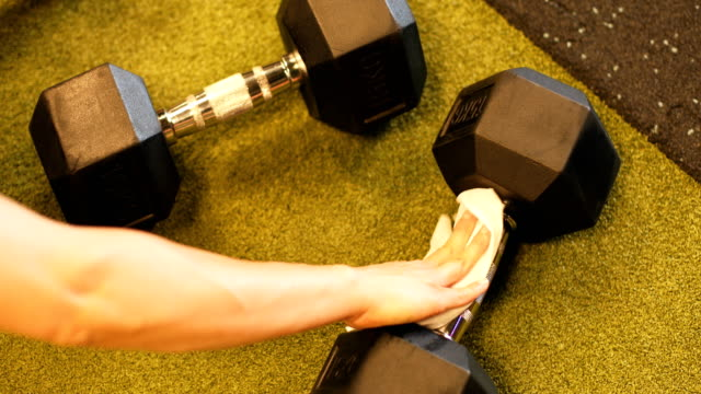 carefully cleaning the weights after use - weights stock videos & royalty-free footage