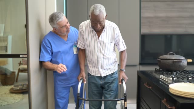 Caretaker assisting senior man with walker Caretaker assisting senior man with walker medicare stock videos & royalty-free footage