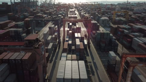 Cargo Container in Port at Sunset Cargo Container in Port at Sunset harbor stock videos & royalty-free footage