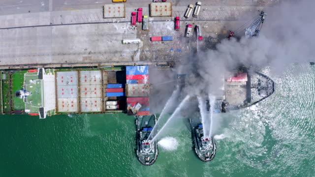stockvideo's en b-roll-footage met vracht brand ongeval in de haven - tegenslag