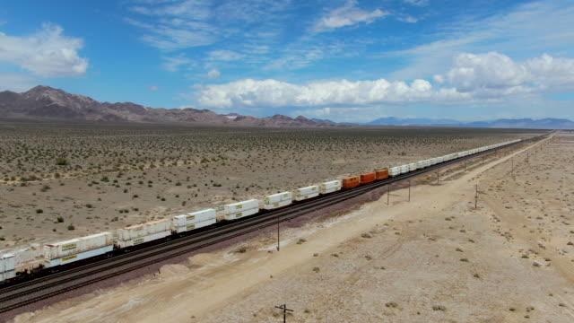 Cargo locomotive railroad engine crossing Arizona desert wilderness