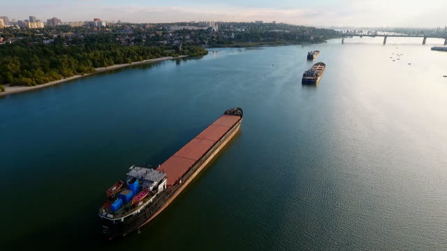 Cargo ship in green river water. video