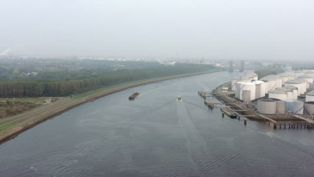 cargo ship in the port of rotterdam in the late hazy evening - rotterdam video stock e b–roll