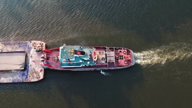 cargo ship on the river view from the height of the quadcopter - chiatta video stock e b–roll