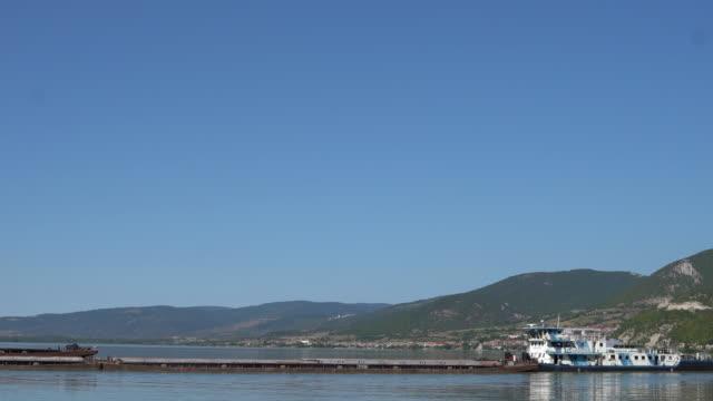 Cargo ship sails the river