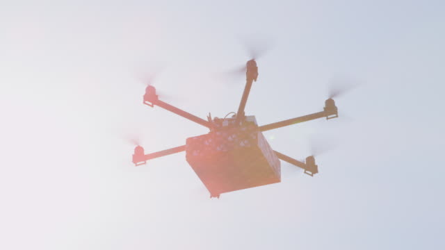 CLOSE UP LENS FLARE Cargo shipping drone bringing birthday present to your home. video