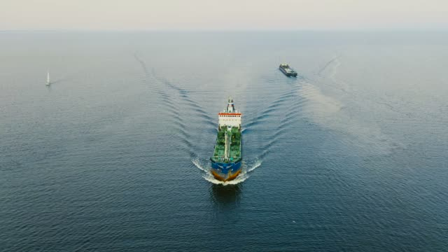 cargo tanker with oil products floats on water in the gulf of the north seas, aerial view - chiatta video stock e b–roll
