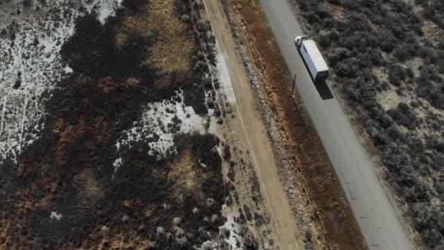 Cargo Transport Long Haul Semi Truck On a Rural Western USA Colorado Access Road 4K Video