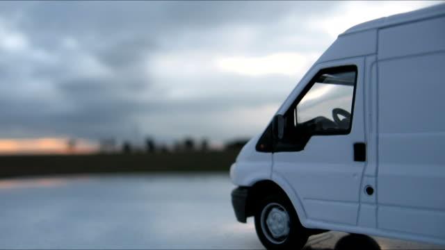 Cargo van Model cargo van and fast clouds. Timelapse vänskap stock videos & royalty-free footage