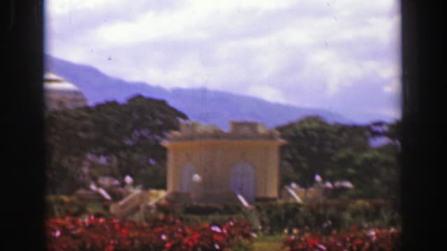 1957: Caribbean tropical palm tree royal government civic wealthy powerful building. video