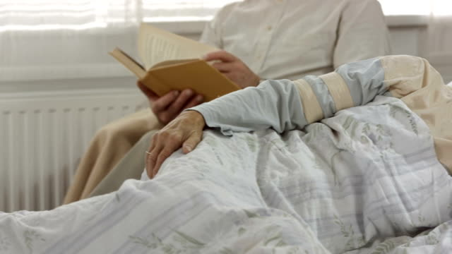 HD DOLLY: Caring Husband Reading To His Sick Wife video