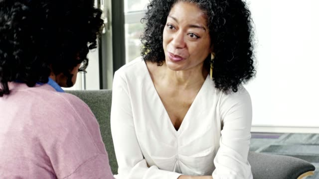 Caring mental health professional encourages anxious patient
