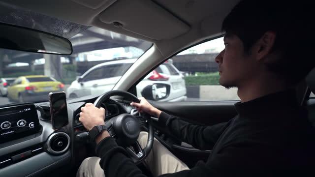 Carman using navigation GPS application on smart phone in car