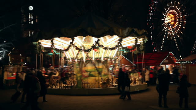 Carnival at night  - Carousel with may people video