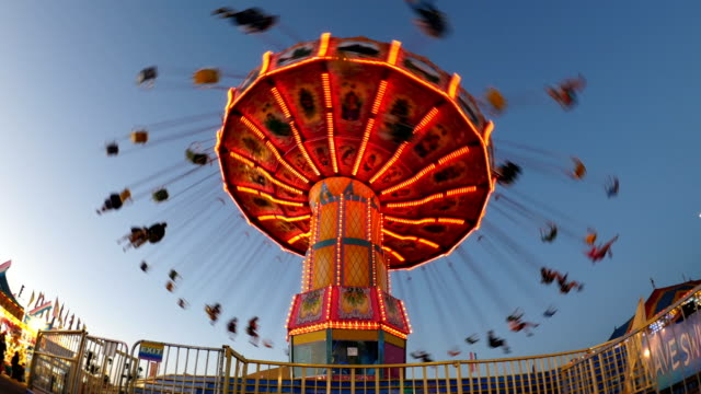 carnival fair swing ride at midway - luna park video stock e b–roll