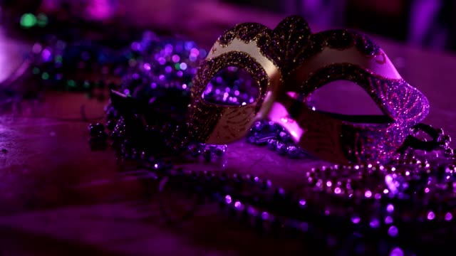 Carnival mask and beads as Mardi Gras decoration Purple venetian carnival mask and beads decorated for Mardi Gras celebration mardi gras stock videos & royalty-free footage