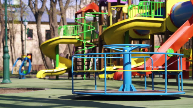 Carousel spinning on empty playground during pandemic video