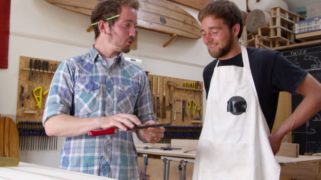 Carpenter And Apprentice Make Surfboards Shot On RED Camera video