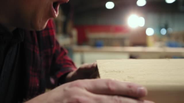 carpenter at work in woodshop - segatura video stock e b–roll