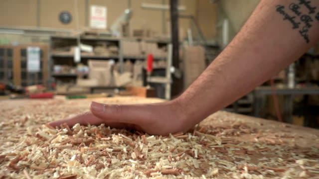 Carpenter  Brusing Off Wood Shavings video