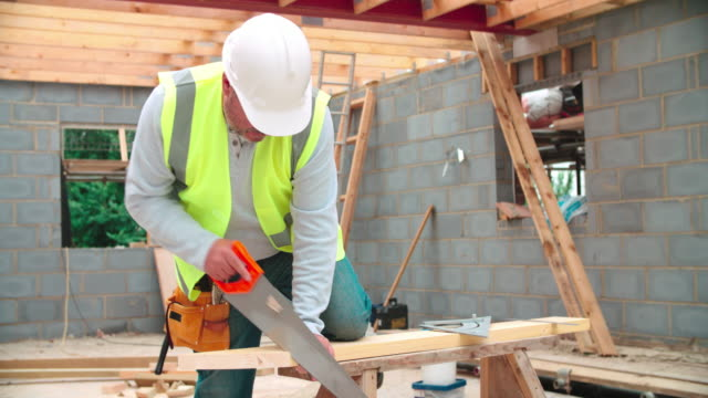 Carpenter Cutting House Roof Supports On Building Site video