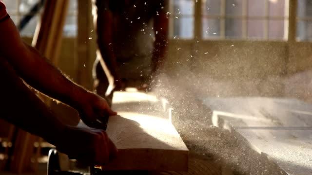 Carpenter cutting wooden plank video